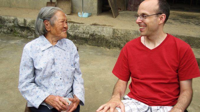 Liu Chenggui, 85, sits with John Smagula. Chenggui lives in the village of Tongzigou, 10 miles away from Shuya, China. | COURTESY John Smagula