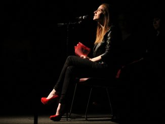 """El Faust, a performer in The Vagina Monologues, reads a monologue about a female laywer-turned-sex-worker in """"Woman Who Like to Make Women Happy.""""   Rob Dirienzo TTN"""