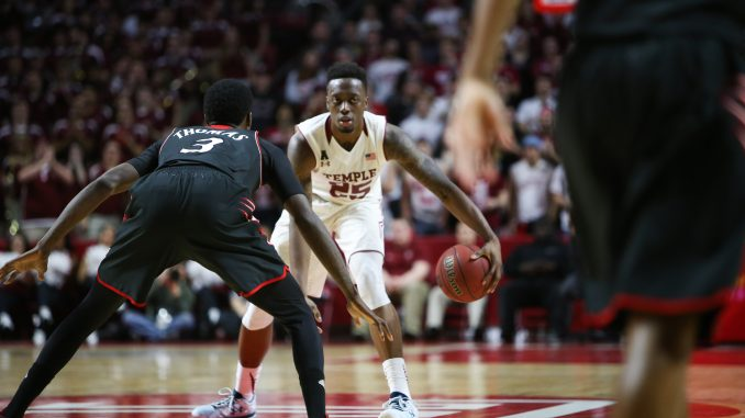 Junior guard Quenton DeCosey dribbles during the Owls' 75-59 win against Cincinnati. The Union, New Jersey native is averaging 12.7 points through the first 26 games of the season. | Jenny Kerrigan TTN