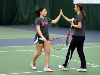 Freshman athlete Yana Khon (left) high-fives teammate Alina Abdurakhimova during practice at the Legacy Center, the Owls' practice facility. Kara Milstein | TTN