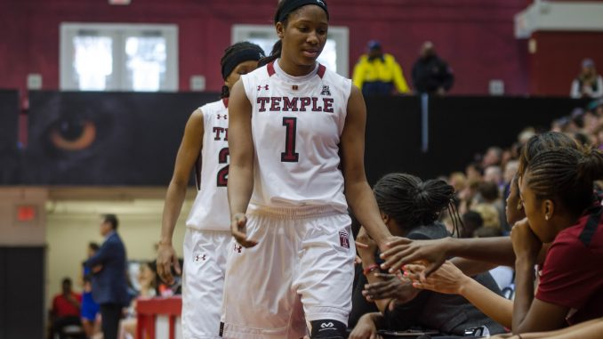 Junior guard Erica Covile and senior guard Tyonna Williams high-five teammates on their way to the bench during the Owls' 83-49 loss against Connecticut Feb. 1. | Bradley Vassalo TTN FILE PHOTO