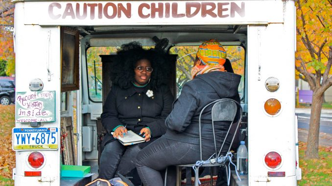Kaycee Itohan Osadolor conducts an oral history interview inside Erin Bernard's truck. | COURTESY Jill Saul