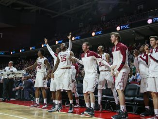 Men's basketball players cheer during the Owls' 77-59 win against National Invitation Tournament foe Louisiana Tech last Wednesday night. | Jenny Kerrigan TTN