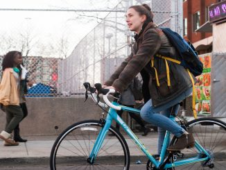 Lily Goldberg rides her bicycle on Montgomery Avenue to raise money for affordable housing. Goldberg and Dustin Miller will ride their bikes from Charleston, South Carolina to Santa Cruz, California. | Allan Barnes TTN