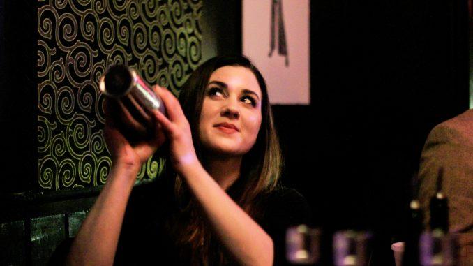 "Allison Hangen of The Olde Bar mixes a signature cocktail, the ""Meyer Lansky,"" at the Trestle Inn's Bourbon Battle. | Harrison Brink TTN"