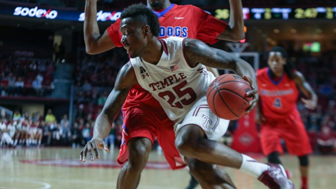 Owls junior guard Quenton DeCosey (front) led the team with 21 points Wednesday night in Temple's 77-59 win against Louisiana Tech in a National Invitation Tournament quarterfinal. The Owls will move on to play the University of Miami next Tuesday at Madison Square Garden in Manhattan. | Jenny Kerrigan TTN