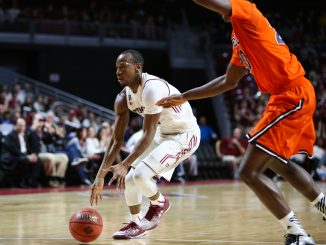 Senior guard Will Cummings (left) looks to gain possession of the ball in Temple's 73-67 win against Bucknell Wednesday night. Cumming netted a season-high 30 points in his team's first victory in a National Invitation Tournament since 2003. | Jenny Kerrigan TTN