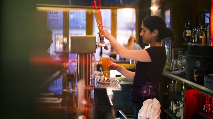 At Earth - Bread + Brewery, Liz Martino, bartender, pours a drink from one of 11 beers on tap that are constantly changing.   Margo Reed TTN