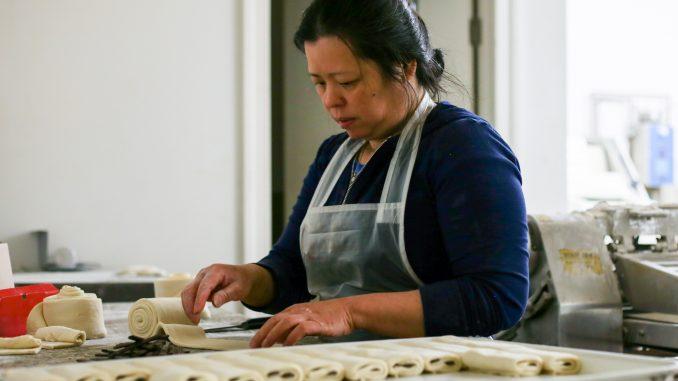 Amanda Eap rolls dough used to make authentic croissants, Artisan Boulanger Patissier's speciality. | Eamon Dreisback TTN