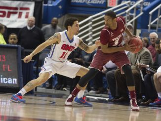Owls senior guard Jesse Morgan protects the ball in Temple's 69-56 loss to SMU Saturday in a semifinal of the American Athletic Conference tournament. | Donald Otto TTN
