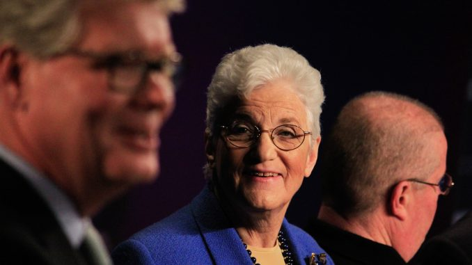 Mayoral candidate Lynne Abraham (center) looks at NBC10's Jim Rosenfield, moderator of a debate held last Tuesday at the Kimmel Center. | Harrison Brink TTN