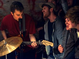 Members of the audience sing along to emo/punk band Marietta's set at Lavender Town on March 28.   Emily Dubin TTN