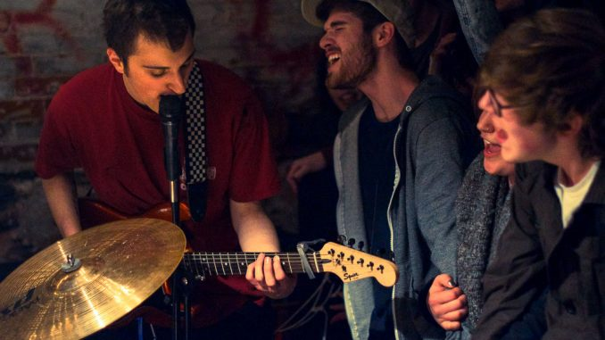 Members of the audience sing along to emo/punk band Marietta's set at Lavender Town on March 28. | Emily Dubin TTN
