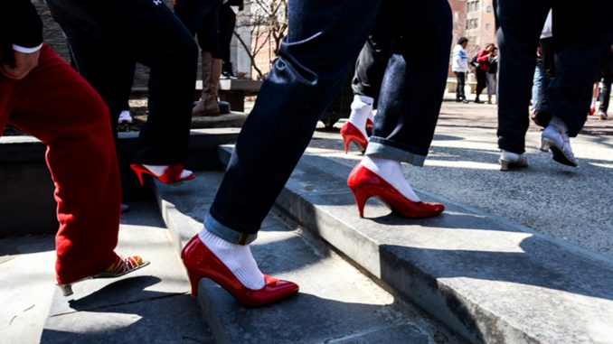 """On April 1, hundreds of male students marched to stop rape, sexual assault and gender violence. assault and gender violence. assault and gender violence. """"Walk A Mile In Her Shoes,"""" an international men's march to stop rape, sexual assault and gender violence. 