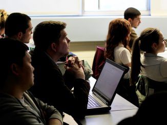 Professor Jonathan Latko listens to a presentation by student Theresa Smurkowski in his Marketing for Sustainable Enterprise class on April 2. the Sustainable Enterprise class on Thursday, April 2. | Harrison Brink TTN