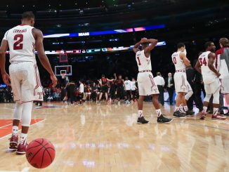 The men's basketball team walks off the court at Madison Square Garden after the squad's 60-57 loss to the University of Miami in the National Invitation Tournament semifinal last Tuesday. | Jenny Kerrigan TTN