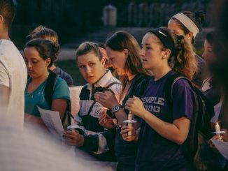 "Attendees of the vigil sang along to R. Kelly's ""The World's Greatest"" in support of Rachel Hall and her family. Hall's lacrosse team played the song before games this spring.
