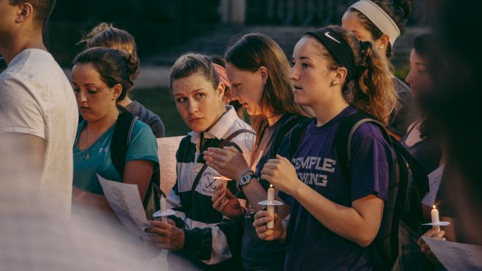 """Attendees of the vigil sang along to R. Kelly's """"The World's Greatest"""" in support of Rachel Hall and her family. Hall's lacrosse team played the song before games this spring.  Aaron Windhorst TTN"""