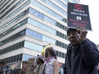 """Franklin Ford, 87, marches in the """"Philly is Baltimore"""" protest on April 30.   Harrison Brink TTN"""