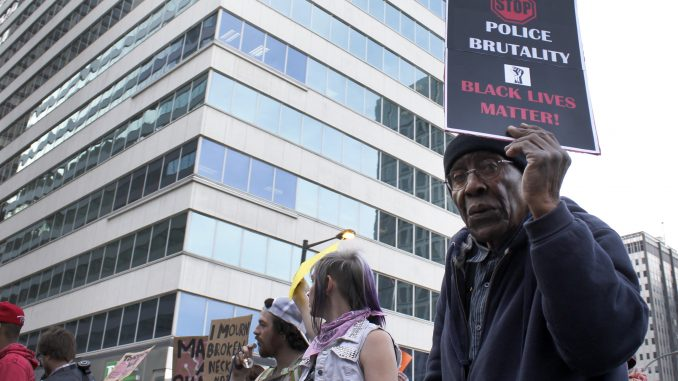 "Franklin Ford, 87, marches in the ""Philly is Baltimore"" protest on April 30. 