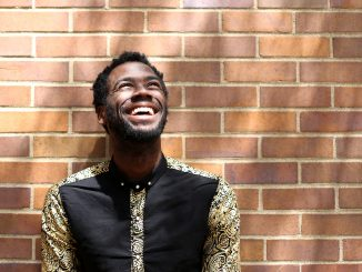Darryl Gene Daughtry Jr. stands in front of Conwell Dance Theater at Boyer College of Music and Dance, where he has performed on stage over the past four years as an undergraduate theater student. | Jenny Kerrigan TTN