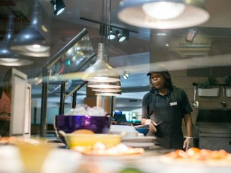 Arnessa Smith works at the Saffron Grill, a Halal station that was added to the Valaida S. Walker Food Court this summer. | Margo Reed TTN