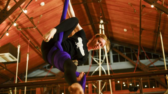 Rebecca MoDavis practices her routine on the silks for Tangle Movement Arts' upcoming show at Fringe Festival. | Brianna Spause TTN