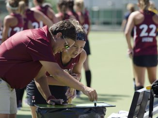 Coach Marybeth Freeman talks with sophomore midfielder Rachael Mueller during the team's 1-0 victory over Drexel University in a scrimmage last Saturday.   Margo Reed TTN