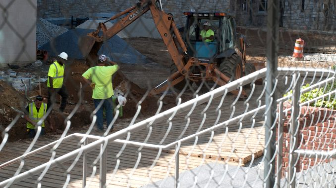 A construction crew works on Liacouras Walk, which has been under construction since June. | Allan Barnes TTN