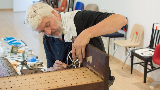 Randy Cleaver, horologist, works on a 19th century flute clock in Temple Contemporary as part of the Restoring Ideals project. | Thomas Joyce TTN