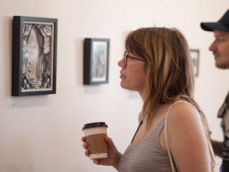 Sara Pindexter and Doug Woods view Eckman-Lawn's work. | Patrick Clark TTN