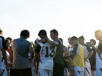 The Owls huddle during their 3-1 victory against Rider Sept. 8. It was the team's third win of the year. | Brian Tom TTN