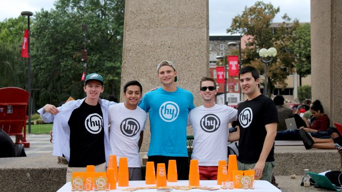 Temple's Hangify representatives Kevin Foster (left), Daniel Garton, Ethan Dombroski, Jack Sheerin and Ben Math promote Hangify at the Bell Tower last Friday. | Madeline Archambault TTN