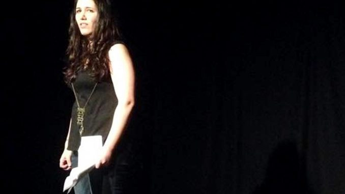 """ReVamp member, Lisa Fischel, performs in """"Shit Men Have Said to Me"""" at the 2015 Mz. Fest. 