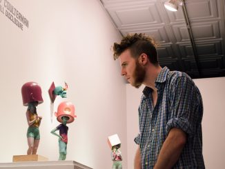 """Scott Stitzer views Troy Coulterman's work at Arch Enemy Gallery in the """"Imaginary Menagerie exhibit"""" last Friday. 