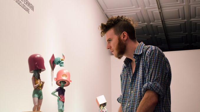 "Scott Stitzer views Troy Coulterman's work at Arch Enemy Gallery in the ""Imaginary Menagerie exhibit"" last Friday. 