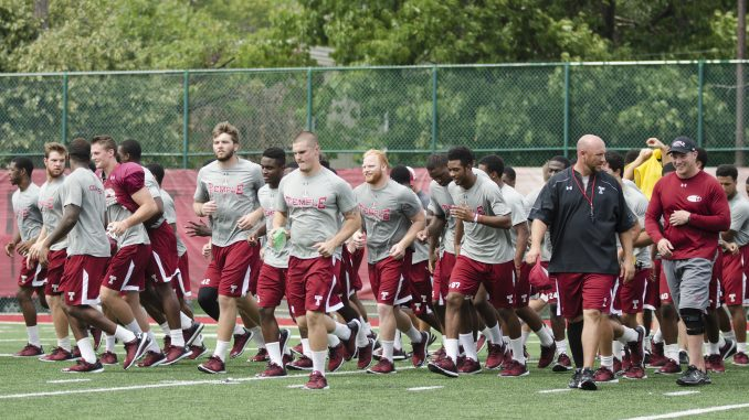 The football team runs off Chodoff Field after a recent practice. The team opens up its season against Penn State Sept. 5 at Lincoln Financial Field. | Margo Reed TTN