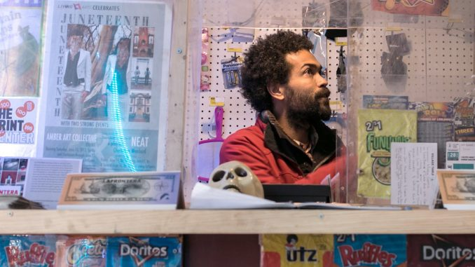 """Keir Johnston, one of the co-founders of the """"La Frontera,"""" sits in the bodega created with the goal of building a stronger bond in the North Philadelphia community. 