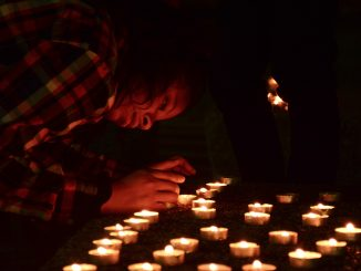 2) Jamya Day, treasurer of the Queer People of Color at Temple, prepares for the vigil that was held in honor of Keisha Jenkins at the Bell Tower, Oct. 12. | Linh Than TTN