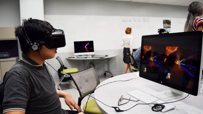 Linh Dang, student, navigates through a fantasy world using the a virtual reality headset at Paley Library's Digital Scholarship Center Sept. 30. | Geneva Heffernan TTN