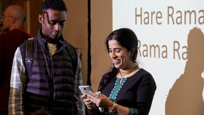 Mangal-Aarti Devi Dasi (right), one of the organizers of the Bhakti Yoga Club, talks to students about the club's programs Oct. 1. | Daniel Sebastian TTN