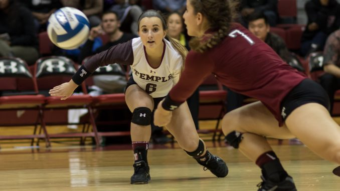 Senior libero Alyssa Drachslin (right) attempts to save the ball during the Owls' 3-0 against Memphis. | Donald Otto TTN