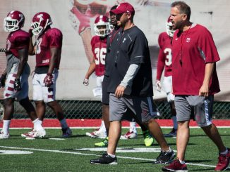 Coach Matt Rhule (right) and offensive coordinator Marcus Satterfield walk on Chodoff Field during a recent practice. | Daniel Rainville TTN