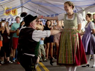 Festival-goers dressed in traditional attire to attend Frankford Hall, showcasing German dancing and music.   Patrick Clark TTN