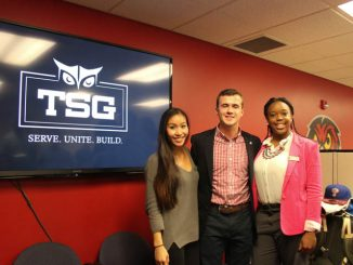 Vice President of External Affairs Binh Nguyen, Student Body President Ryan Rinaldi and Vice President of Services Brittany Boston stand in front of Temple Student Government's new logo Thursday afternoon. | Kathryn Stellato TTN