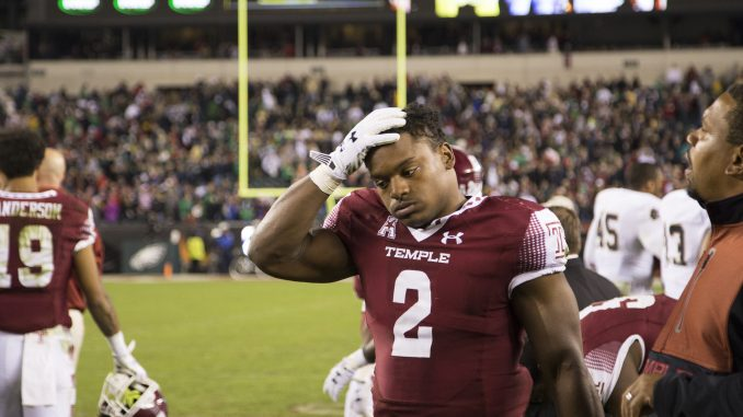 Redshirt-junior linebacker Avery Williams walks off the field following the Owls' 24-20 defeat Saturday against Notre Dame at Lincoln Financial Field. | Jenny Kerrigan TTN
