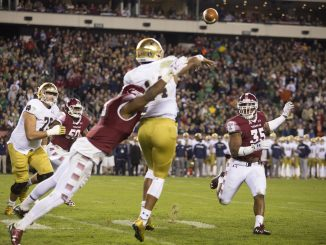 Notre Dame quarterback Deshone Kizer is tackled as he throws the ball Saturday. | Jenny Kerrigan TTN
