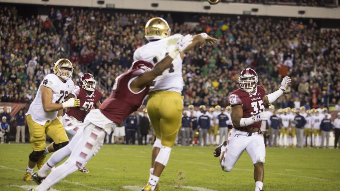 Notre Dame quarterback Deshone Kizer is tackled as he throws the ball Saturday. | Jenny Kerrigan TTN
