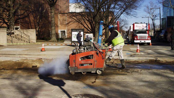 A construction worker digs up part of Norris Street near 13th earlier this week.   Joshua Dicker TTN