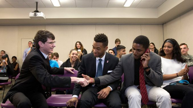 Empower TU presidential candidate Aron Cowen (left) shakes campaign manager Tykee James' hand after learning they had won the 2016-17 TSG election. | DAN RAINVILLE TTN